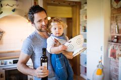 Young father with a toddler boy cooking. Royalty Free Stock Photo