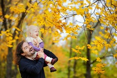 Young father and toddler girl have fun at autumn Stock Photography