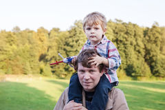 Young father and toddler walking in summer landscape Royalty Free Stock Photos