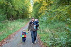 Young father and toddlers walking in autumn Royalty Free Stock Photos