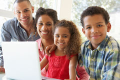 Young Father Using Laptop At Home Royalty Free Stock Photo