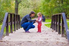 Young father walking with his little daughter in Royalty Free Stock Images