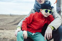 Young Father With His Son Having Fun Outside In Spring Field, Happy Family Smiling, Lifestyle People Making Selfie Stock Photography
