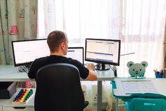 Young Father Working From Home During Quarantine In Children`s Room Stock Photo