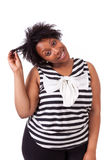 Young fatty black woman holding her hairs - African people Royalty Free Stock Photo