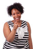 Young fatty black woman pointing to the screen - African people. Young fatty black woman pointing to the screen, isolated on white background - African people Stock Photography