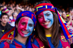 Young FC Barcelona supporters. BARCELONA - MAY 13: Unidentified FC Barcelona supporters celebrate the Spanish League Championship victory in Camp Nou stadium, on Stock Photo