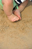 Young feet on sand Royalty Free Stock Images