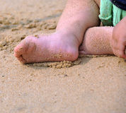 Young feet on sand Royalty Free Stock Photos