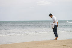 Young fellow at China Beach in Danang of Vietnam Stock Photos