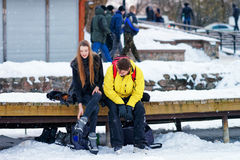 Young fellow and girl wearing skates in Trakai Lithuania Stock Image
