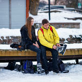 Young fellow and girl wearing skates in Trakai Royalty Free Stock Photography