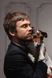 Young fellow with his dog. Young man hugging his jack Russell terrier dog Royalty Free Stock Photos