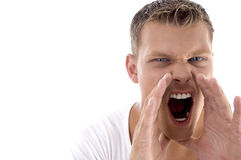 Young fellow shouting loudly Stock Photos