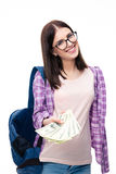 Young femael student giving money on camera Royalty Free Stock Images