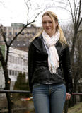 Young Female. Blond female leaning agaist a metal rail, Oslo Norway Stock Images