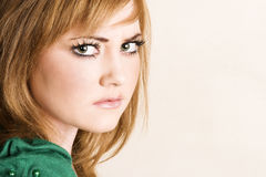 Young Female. Beautiful young model with striking green eyes stock photos