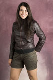 Young Female. Beautiful young female wearing shorts and a leather jacket royalty free stock photography