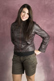 Young Female. Beautiful young female wearing shorts and a leather jacket royalty free stock photo