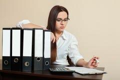 Young female accountant hugs documents folders stock image
