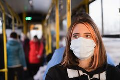 Free Young Female Adult Commutes In A Protective Face Mask. Coronavirus, COVID-19 Spread Prevention Concept, Responsible Social Royalty Free Stock Images - 175338399