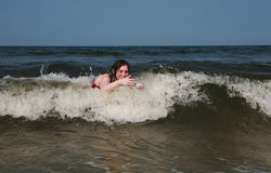 Young female adult playing in ocean stock photo