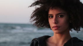 Young female with afro hairstyle look at the camera stock video