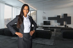 Young Female Agent Posing at the Living Room royalty free stock image