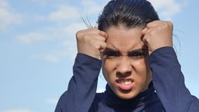 Young Female And Anger. A pretty young Colombian teen girl Stock Photography