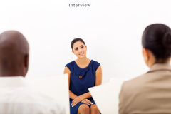 Job interview. Young female applicant during job interview royalty free stock images