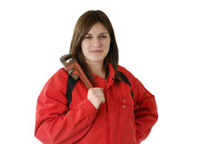 Young female apprentice in with screscent wrench Stock Photo