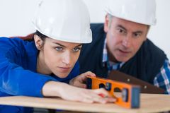 Young female apprentice wit level. Female stock photo