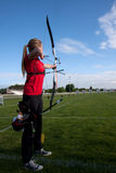 Young female archer. AUCH, FRANCE - MAY 11:  an unidentified female competitor is shooting with a bow and an arrow, at the National tournament for young archers Royalty Free Stock Photo