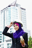 Young female architect. Beautiful and young female architect using a helmet looking stright Royalty Free Stock Images