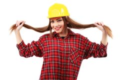Young female architect or builder wearing a yellow hart hat on a Royalty Free Stock Images