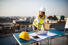 Young woman architect, construction engineer at a construction site royalty free stock photos