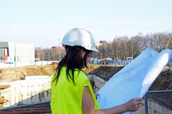 Young female architect at the construction site of the construction project Royalty Free Stock Images