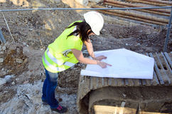 Young female architect at the construction site of the construction project Stock Photo