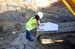 Young female architect at the construction site of the construction project Stock Photos