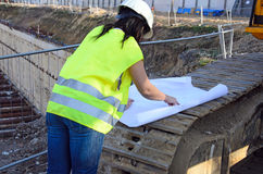 Young female architect at the construction site of the construction project Royalty Free Stock Image