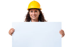 Young female architect holding a blank sign Royalty Free Stock Photo