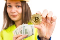 Young female architect holding cash and bitcoin stock image