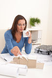 Young female architect holding cup of coffee Royalty Free Stock Photos