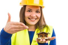 Young female architect holding miniature house royalty free stock photo