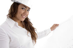 Young female architect holding open blue prints Royalty Free Stock Photos
