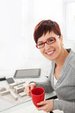 Young female architect loves working in his office Stock Photo