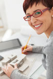 Young female architect loves working in his office Royalty Free Stock Photo