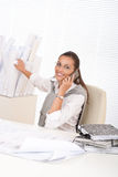 Young female architect with phone Royalty Free Stock Photo