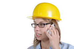 Young female architect on the phone. Isolated on white background Stock Image