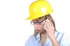 Young female architect on the phone Royalty Free Stock Images